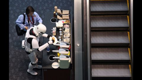 """A man dressed as a """"Star Wars"""" stormtrooper prepares a hot dog during the 2011 WonderCon in San Francisco."""