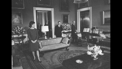 """First lady Jackie Kennedy is shown in the Red Room of the White House on January 15, 1962, during the CBS News special program """"A Tour of the White House with Mrs. John F. Kennedy."""" The program showed off the restoration work that was spearheaded by the first lady."""