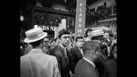 """The 1968 Democratic Convention, held in Chicago, was a scene of chaos both inside and outside the convention hall. At one point, CBS correspondent Dan Rather, center, was treated roughly by security, prompting anchor Cronkite to comment, """"I think we've got a bunch of thugs here, Dan."""" Outside, protesters chanted, """"The whole world is watching."""""""