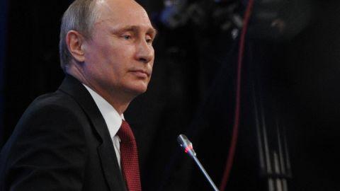Russia's President Vladimir Putin attends an economic forum in Saint Petersburg, on May 23, 2014.
