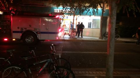 Fire trucks are parked outside an Isla Vista mart Friday night after the deadly rampage. The shootings occurred in a crowded area bustling with activity on Memorial Day weekend.<br />