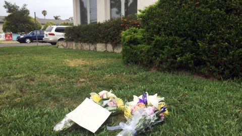 Flowers lay in front of the Alpha Phi sorority in Isla Vista, California on May 24.