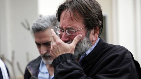 """Richard Martinez, father of victim Christopher Martinez, breaks down as he talks to media outside the Santa Barbara County Sheriff's Office. """"Our family has a message for every parent out there: You don't think it will happen to your child until it does,"""" the visibly emotional parent said."""