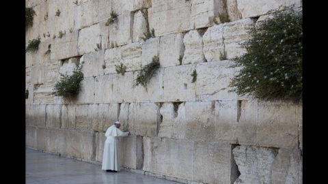 Pope Francis prays in front of the Western Wall in Jerusalem's Old City on Monday, May 26.