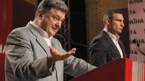 """Ukraine's newly elected president, Petro Poroshenko, talks alongside Klitschko, right, during a news conference in Kiev on May 26. Poroshenko, a billionaire candy tycoon known as the """"Chocolate King,"""" is a seasoned politician known for his pro-European Union views."""
