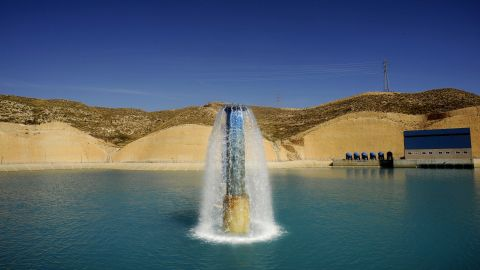 Fresh water flows into a reservoir after treatment at a desalination plant near Almeria, southern Spain.