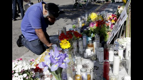Jose Cardoso pays his respects Sunday, May 25, at a makeshift memorial in front of the IV Deli Mart, where part of Friday's mass shooting took place, in Isla Vista, California.