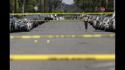 A Santa Barbara County deputy sheriff walks along the street May 24 near a shooting scene in Isla Vista.