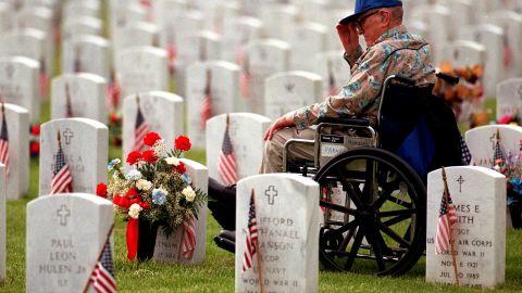 Air Force veteran Joseph Parnell Sr., 81, visits the grave of his son, Joseph Parnell Jr., at Fort Logan National Cemetery.