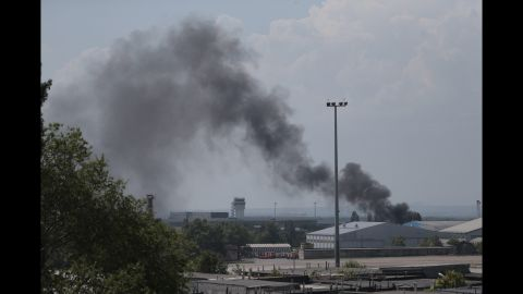 Smoke rises from the airport on May 26 after an airstrike by the Ukrainian military.