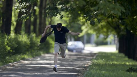 A man runs for cover during fighting around the airport on May 26.