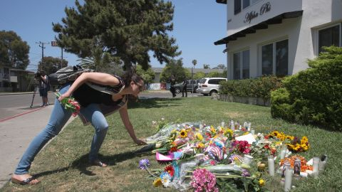 Caption:ISLA VISTA , CA - MAY 25: A woman places flowers on the lawn of the Alpha Phi sorority house May 25, 2014 in Isla Vista, California. According to reports, 22 year old Elliot Rodger, son of assistant director of the Hunger Games, Peter Rodger, began his mass killing near the University of California in Santa Babara by stabbing three people to death in an apartment. He then went on to shooting people while driving his BMW and ran down at least one person until crashing with a self-inflicted gunshot wound to the head. Officers found three legally-purchased guns registered to him inside the vehicle. Prior to the murders, Rodger posted YouTube videos declaring his intention to annihilate the girls who rejected him sexually and others in retaliation for his remaining a virgin at age 22. Seven people died, including Rodger, and seven others wounded, according to authorities. (Photo by David McNew/Getty Images)