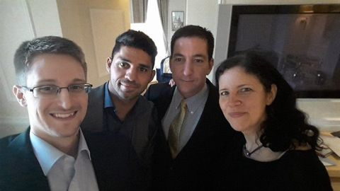 """National Security Agency whistleblower Edward Snowden, left, poses for a photo with, from right, journalist Laura Poitras, journalist Glenn Greenwald and Greenwald's husband, David Michael Miranda. Miranda <a href=""""http://on.fb.me/1ojSRGh"""" target=""""_blank"""" target=""""_blank"""">posted the selfie</a> to his Facebook page on Thursday, May 22. Greenwald was the journalist who broke the Snowden story last year."""