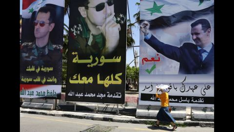 Portraits of al-Assad dominate the cityscape in central Damascus on Tuesday, May 27. Al-Assad is firmly in power three years into the civil war, while the opposition remains weak and fragmented and extremists grow in numbers and influence.