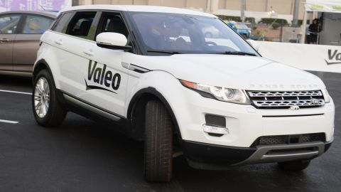 """A Range Rover Evoque equipped with Valeo self-parking technology backs into a parking spot during a <a href=""""http://edition.cnn.com/2014/01/09/tech/innovation/self-driving-cars-ces/"""">driverless car demo at the International Consumer Electronics Show</a> (CES) in January."""