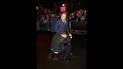 Sediuk wraps himself around the legs of Leonardo DiCaprio at the 29th Santa Barbara International Film Festival in Santa Barbara, California, on February 6.