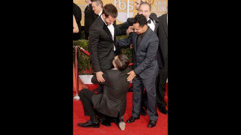 Sediuk hugs Bradley Cooper's legs as Michael Pena looks on at the 2014 Screen Actors Guild Awards in Los Angeles on January 18.