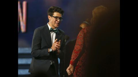 Sediuk runs on stage to greet singer Adele as she wins a Grammy for Best Pop Solo Performance at the 2013 Grammy Awards in Los Angeles.