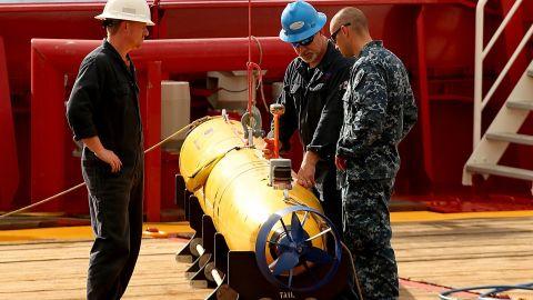 Technicians work on an autonomous underwater vehicle in 2014.