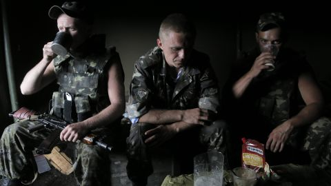 Ukrainian soldiers rest at a che