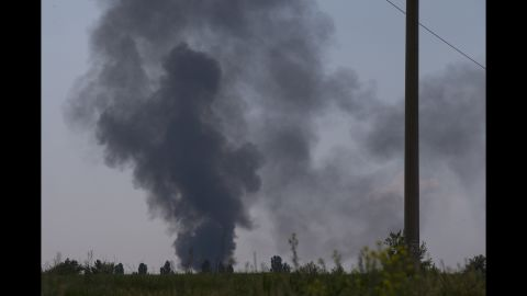 Smoke rises from a shot-down Ukrainian Army helicopter outside Slovyansk on May 29.