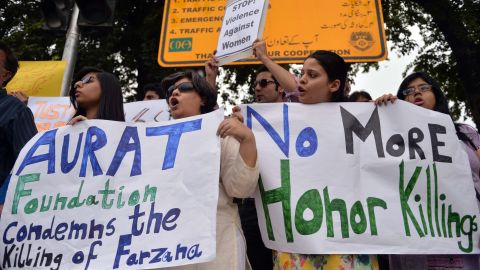 """Pakistani human rights activists hold placards as they chant slogans during a protest in Islamabad on May 29, 2014 against the killing of pregnant woman Farzana Parveen was beaten to death with bricks by members of her own family for marrying a man of her own choice in Lahore. Pakistan's prime minister demanded """"immediate action"""" over the brutal murder of a pregnant woman who was bludgeoned to death with bricks outside a courthouse while police stood by. Farzana Parveen was attacked on May 27 outside the High Court building in the eastern city of Lahore by more than two dozen brick-wielding attackers, including her brother and father, for marrying against the wishes of her family. AFP PHOTO/Aamir QURESHIAAMIR QURESHI/AFP/Getty Images"""