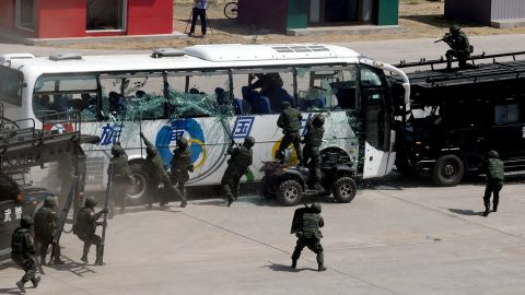 Beijing police officers, including the elite Snow Leopard Commando Unit, show off their skills at handling attempted terror attacks, hijackings and large-scale protests in Beijing on May 29, 2014. Police officers and commandos in Beijing showed off their anti-terrorist prowess, days ahead of the 25th anniversary of the Tiananmen crackdown and following a string of separatist attacks. CHINA OUT AFP PHOTOSTR/AFP/Getty Images