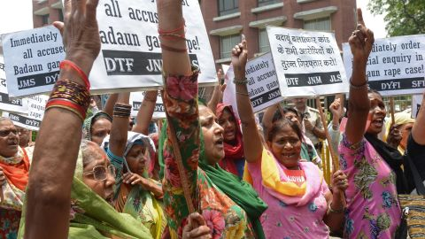 Activists from The All India Democratic Women's Association (AIDWA) and Indian Students Union shout slogans in front of Uttar Pradesh Bhawan in New Delhi on May 31, 2014, against the gang-rape and death of two teenage girls in Budaun district, India's northern state of Uttar Pradesh. Two girls aged 14 and 15 from the lowest Dalit caste have been found hanging from a tree in a northern Indian village after they were gang-raped by five men, police said in a brutal attack highlighting the country's poor record on sexual violence. AFP PHOTO/RAVEENDRAN (Photo credit should read RAVEENDRAN/AFP/Getty Images)