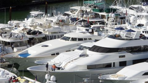 Luxury yachts on display at the Miami Yacht and Brokerage Show in Miami Beach, Florida.