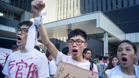 Protesters marched to Hong Kong's government headquarters to demand democracy in Hong Kong and China.