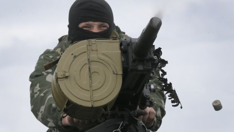 A Ukrainian soldier shoots a grenade launcher during a battle with pro-Russian separatists in Slovyansk on Saturday, May 31.