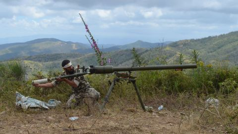 A rebel fighter loads an anti-tank cannon outside Latakia, Syria, on Sunday, June 1.