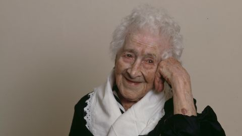 Jeanne Calment was born February 21, 1875, and lived to the age of 122 in Arles, France (home of the painter Vincent Van Gogh, whom she met as a little girl). At 85, she took up fencing lessons. At 100, she was still riding her bike. She said she ate more than 2 pounds of chocolate a week and only quit smoking at age 120 -- not for health reasons but because she could not see well enough to light her cigarettes. She credited her longevity to port wine, her sense of humor and a diet rich in olive oil. She died in August 1997.