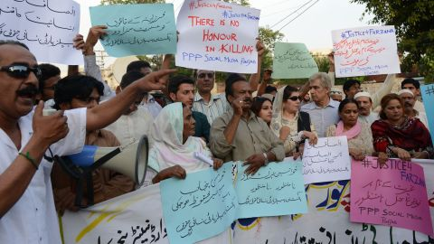 """Pakistani activists from the PPP Social Media hold placards as they chant slogans during a protest against the killing of pregnant woman Farzana Parveen was beaten to death with bricks by members of her own family for marrying a man of her own choice in Lahore on May 30, 2014. Pakistani police investigating the murder of a woman bludgeoned to death outside a court have arrested four men, a senior officer said, as her husband said he wanted her killers to """"die in pain"""". AFP PHOTO/Arif ALIArif Ali/AFP/Getty Images"""