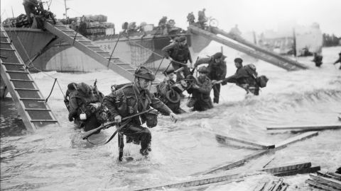 Commandos with the British Royal Navy's 4th Special Service Brigade advance to Juno Beach.