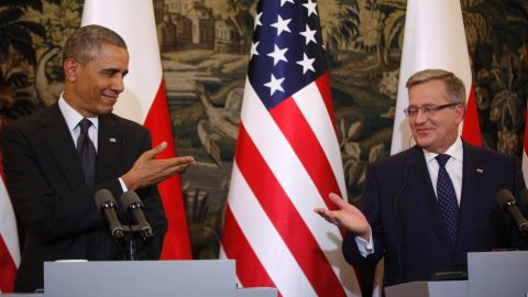 Obama and Komorowski gesture toward each other at a news conference in Warsaw on Tuesday, June 3.