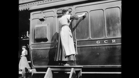 A woman works as a porter at the Marylebone station in London. British propaganda posters declaring soldiers' dependence on female munitions workers gave women a sense that their labor contributions would be important -- and acknowledged. But this was not always the case.