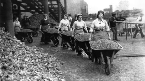 """Women """"navvies"""" work on railway building in Coventry, England."""