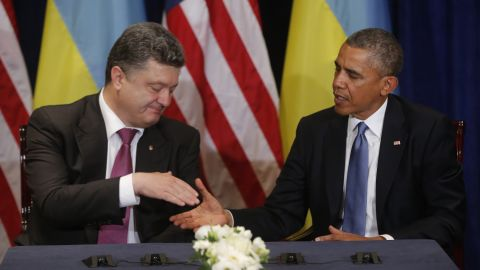 """Obama meets with Ukrainian President-elect Petro Poroshenko in Warsaw on June 4. Obama voiced his support for Poroshenko and called for the international community to """"stand solidly behind"""" him as his government tries to quell a pro-Russian separatist uprising in the country's east."""