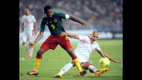 """<strong>Samuel Eto'o (Cameroon):</strong> The first World Cup for Eto'o, left, was in 1998, but don't call him old. He'll make you look silly, as he did in May when he mocked his Chelsea coach, Jose Mourinho, with an <a href=""""http://i2.cdn.turner.com/cnn/dam/assets/140308151112-etoo-reaction-story-top.jpg"""" target=""""_blank"""" target=""""_blank"""">old-man goal celebration</a>. If you ask Eto'o, he has two more World Cups in him. The 33-year-old will prove integral to the Indomitable Lions' campaign, having notched 56 goals in 117 caps (not to mention 300+ goals for clubs in Russia, Italy, Spain and England)."""