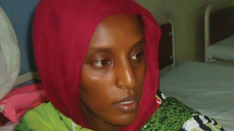 Meriam Yahia Ibrahim Ishag, a 27-year-old Christian Sudanese woman sentenced to hang for apostasy, sits in her cell a day after she gave birth to a baby girl at a women's prison in Khartoum's twin city of Omdurman on May 28, 2014.