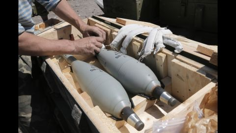 A Ukrainian soldier prepares explosives during a battle with pro-Russian separatists in Slovyansk on June 6.