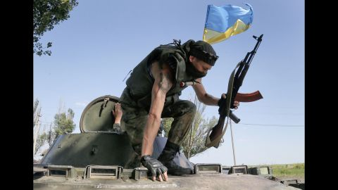 Ukrainian soldiers take position during a battle with pro-Russian separatists outside Slovyansk on June 5.