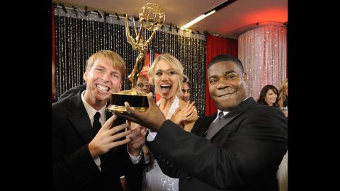 """""""30 Rock"""" cast members joke around with their award for outstanding comedy series backstage at the Emmy Awards in Los Angeles on September 21, 2008. Morgan was also nominated for outstanding supporting actor in a comedy series."""