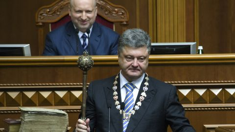 Poroshenko holds the ceremonial mace during his inauguration ceremony Saturday, June 7, in Kiev. Poroshenko was elected three months after the ouster of former President Viktor Yanukovych.