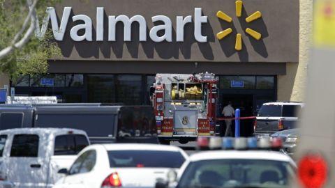 Police and firefighters on the scene of a shooting at a Walmart, on Sunday, June 8 in Las Vegas.