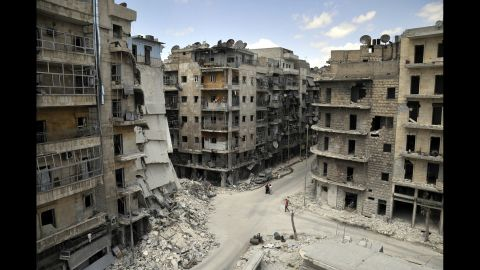 """Apartments and other buildings lie in ruins on Tuesday, June 3, in <a href=""""http://www.cnn.com/2014/06/09/world/meast/syria-aleppo-reporters-notebook/"""">Aleppo, a city that """"has had the life bombed out of it,""""</a> according to CNN's Nick Paton Walsh."""