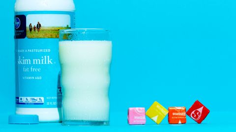 An 8-ounce glass of skim milk has about 11 grams of sugar. A single Starburst candy has 2.7 grams.