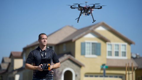 Christopher Brown of the Next New Homes Group uses a drone to take aerial video of a home in Sacramento, California, on February 25, 2014. Drones are increasingly being used by small companies to shoot promotional videos.
