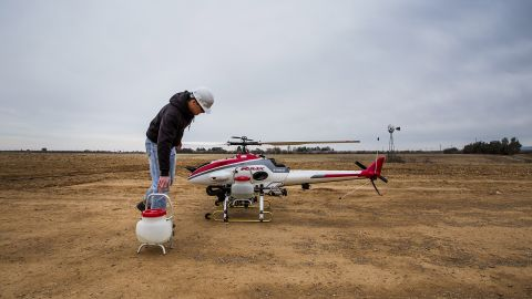 A researcher at the University of California, Davis, removes sprayer containers from a drone after a crop dusting test flight in Arbuckle, California, on February 5, 2014. UC Davis is testing the use of unmanned helicopters for agriculture. The FAA does not currently allow pesticide spraying from drones in the United States.